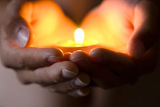 230_hands_candle